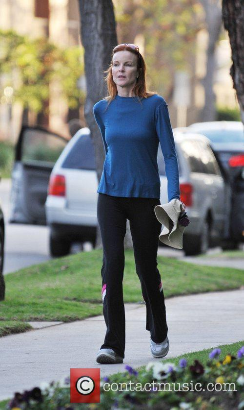 Marcia Cross Checking goes for a power walk...