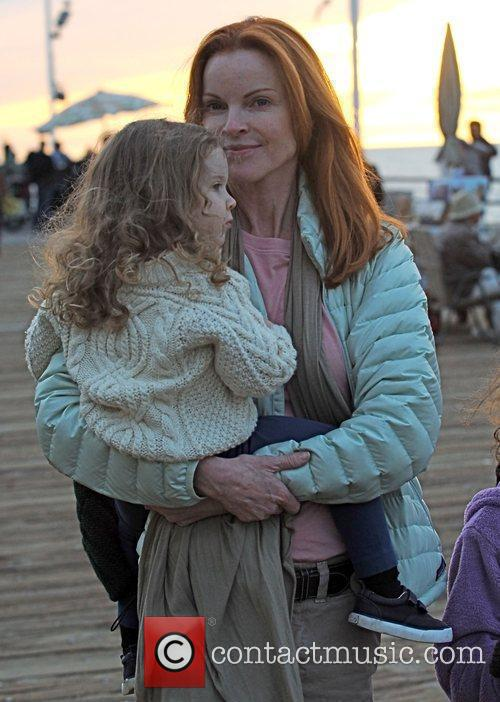 Taking a stroll on the boardwalk with her...