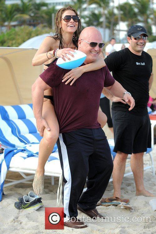Maria Menounos and Michael Chiklis play football at...