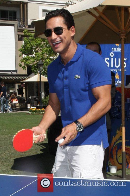 Mario Lopez playing table tennis at his birthday...