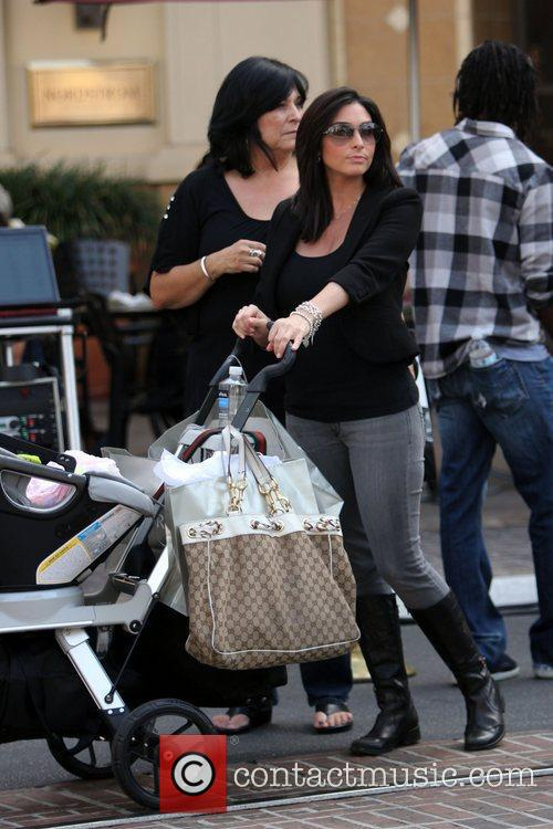 Visits her husband Mario Lopez at The Grove...