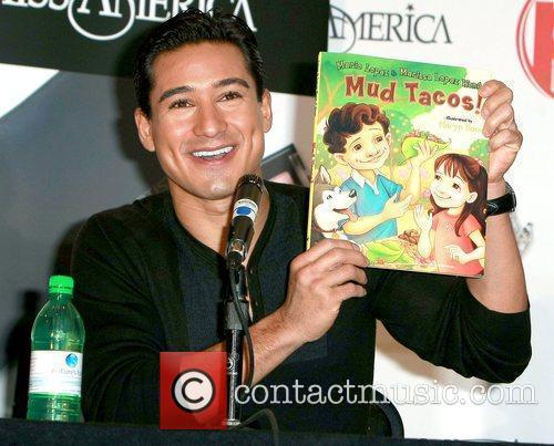 Mario Lopez showing off his book 'Mud Tacos'...