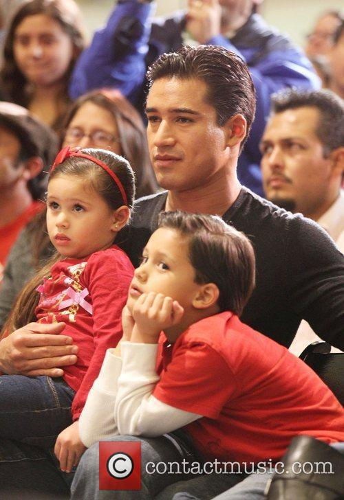 Mario Lopez and his family watch members of...