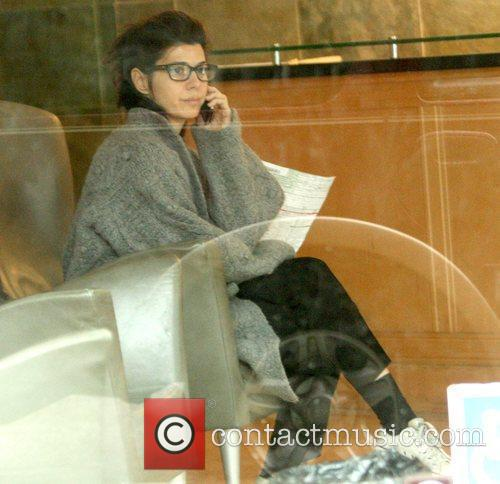 Marisa Tomei talking on her cell phone while...