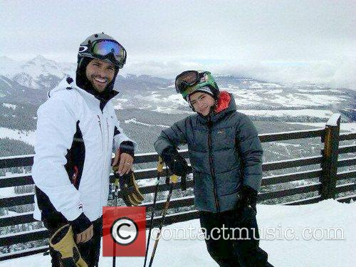 Mark Consuelos posing with his son while skiing...