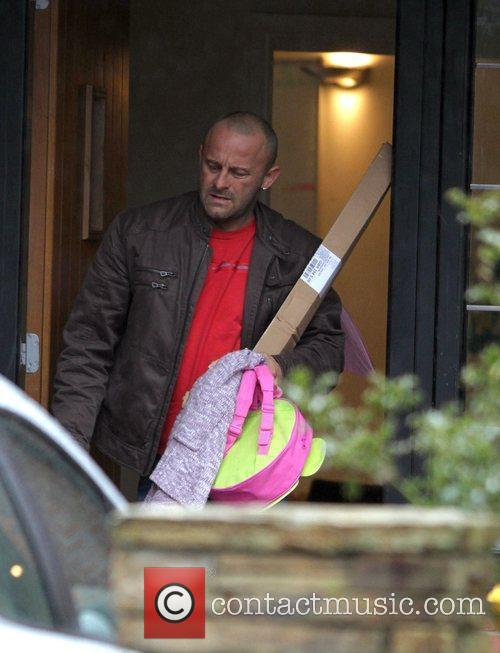 Mark Croft leaves Kerry Katona's home after collecting...