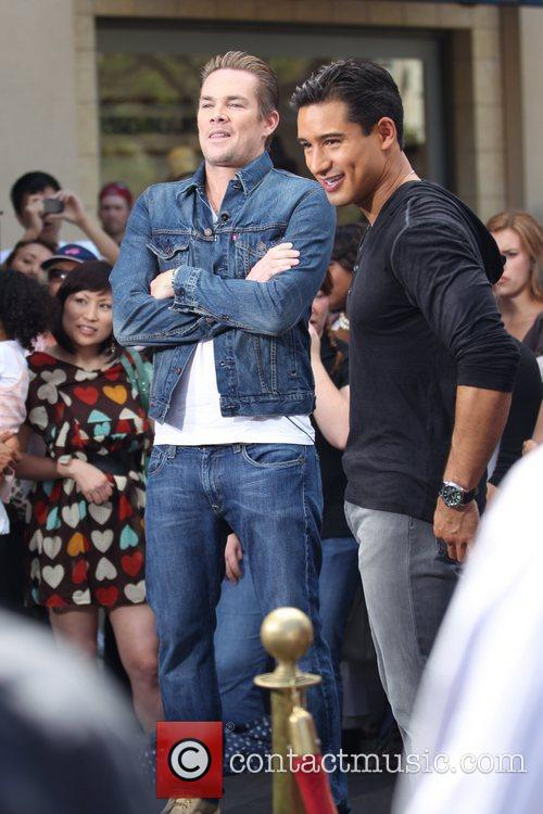 Mark McGrath and Mario Lopez filming an interview...