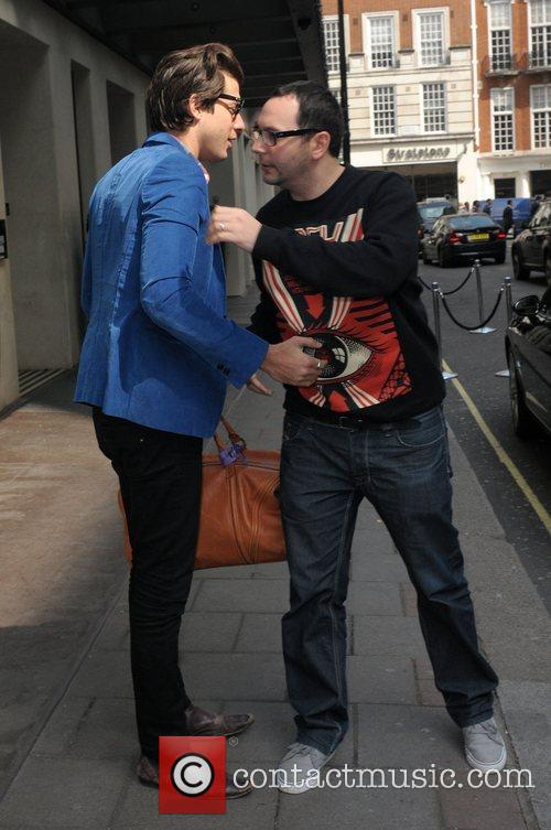 Mark Ronson greets a friend outside the May...