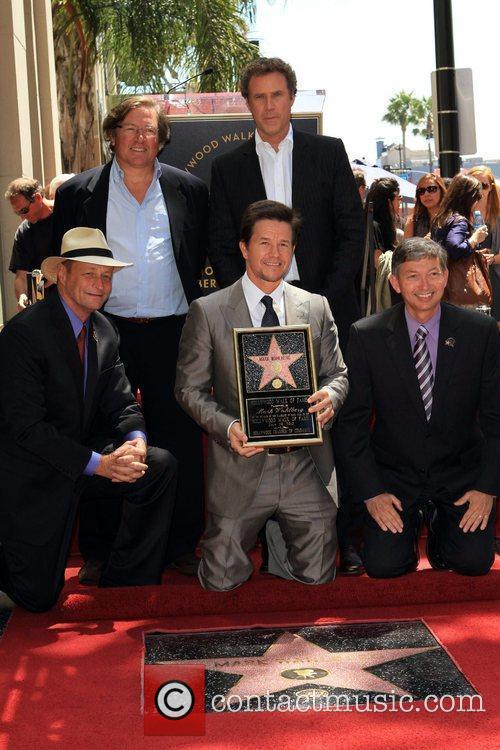 Is honored on The Hollywood Walk of Fame...