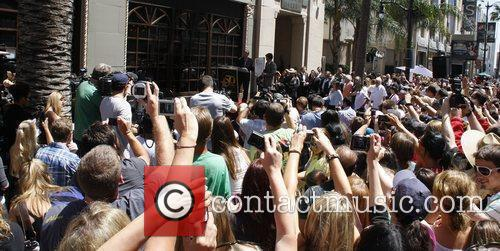 Crowds of fans photographing Mark Wahlberg as he...