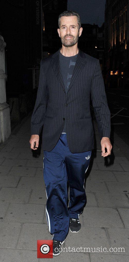 Rupert Everett in tracksuit bottoms and jacket arriving...
