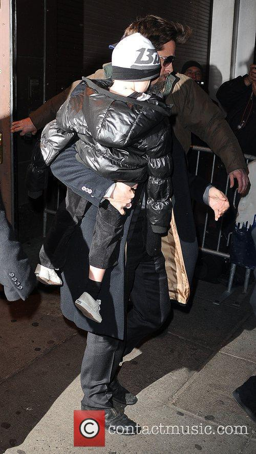 Brad Pitt carries daughter Shiloh Jolie-Pitt leaving the...