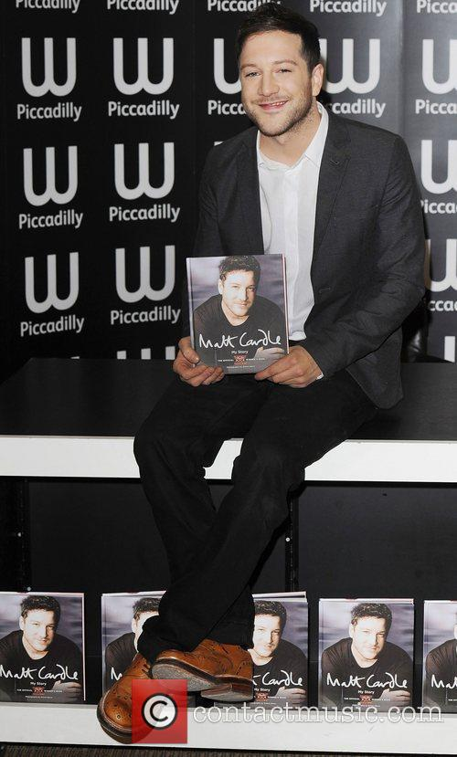 Signing copies of his book 'My Story' at...