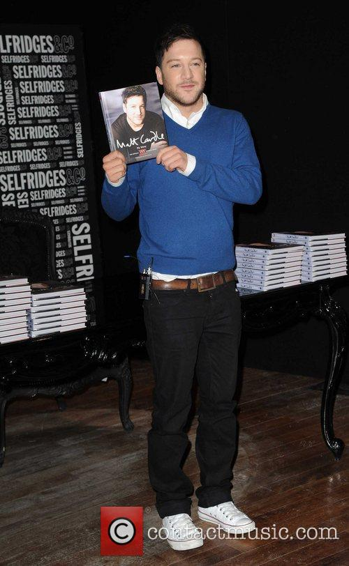 Matt Cardle  Matt Cardle signing copies of...