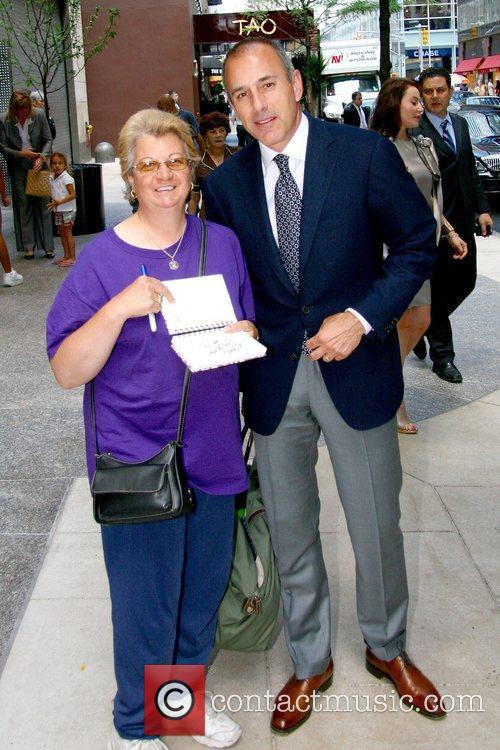 Matt Lauer poses with a fan NBC's 'Today'...