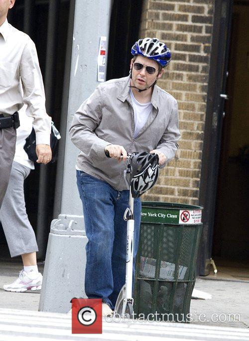 Matthew Broderick riding his scooter in Greenwich Village...