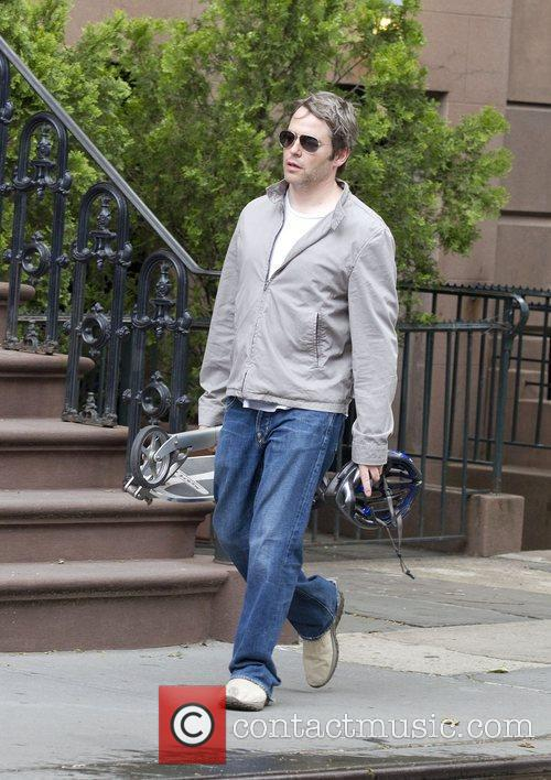 Matthew Broderick carrying his scooter in Greenwich Village...