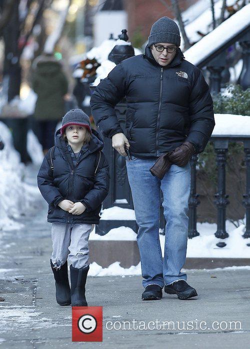 Walking his son James Wilke Broderick to school