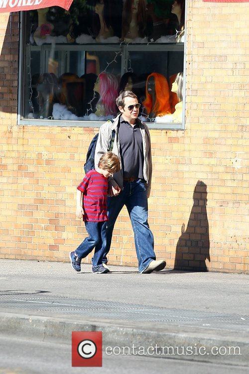Walking his son, James Wilkie Broderick to school