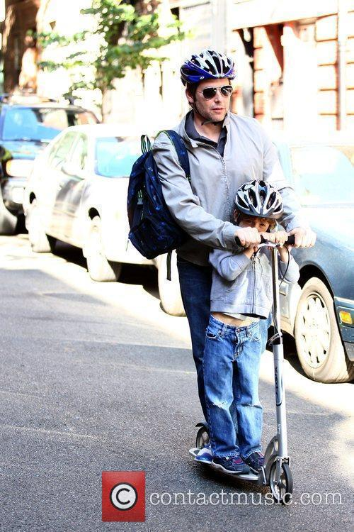 Matthew Broderick riding his scooter with his son...