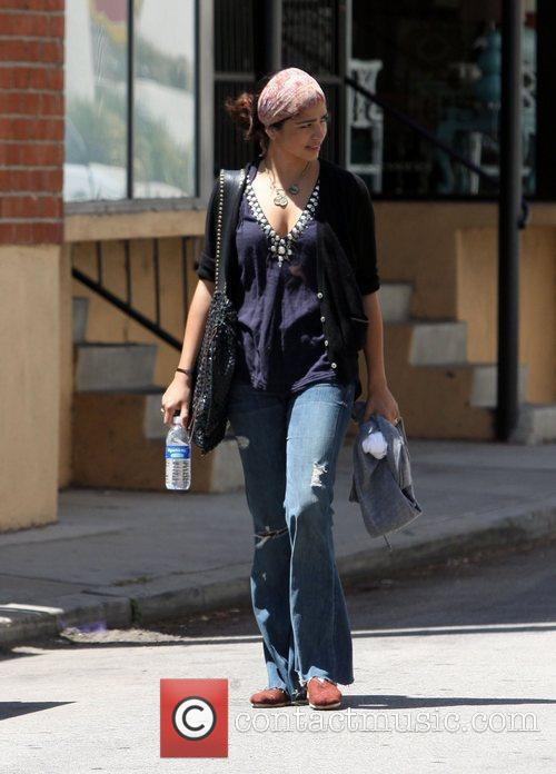 Camila Alves and her husband leaving a gym...