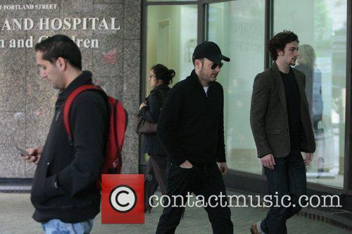 Arriving at the hospital where Vaughn's wife recently...