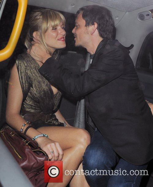 Sienna Miller is given a kiss by her...