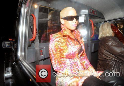 Amber Rose in a taxi arriving at the...