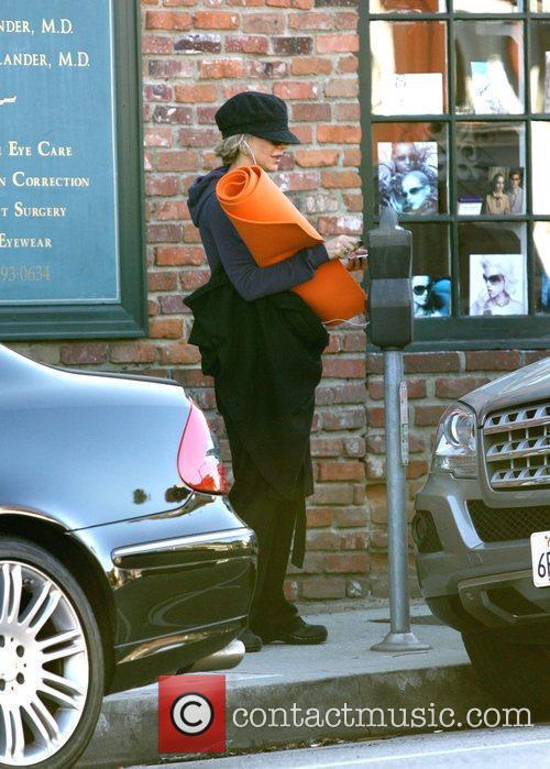 Meg Ryan  carrying her orange yoga mat...