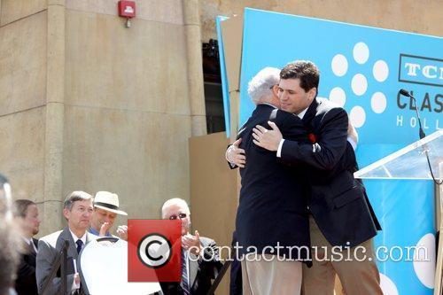 Eddie Brooks and Mel Brooks hugging Mel Brooks...