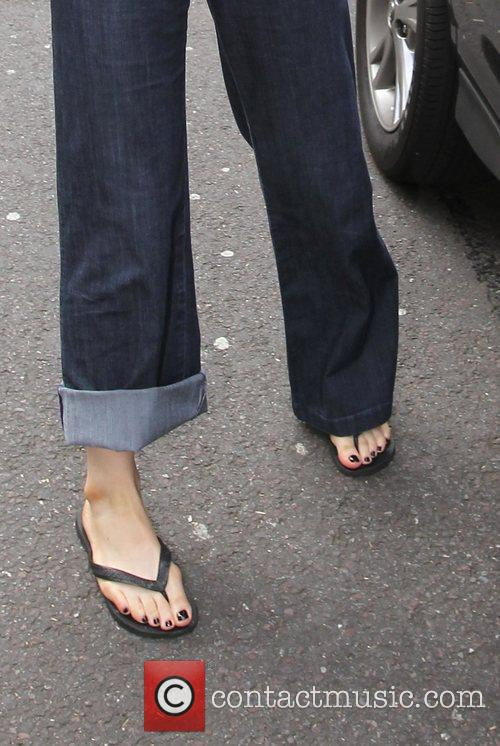 Arrives at the Radio One studios with her...