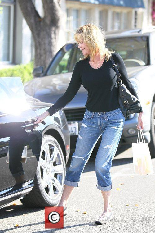 Exits the Neil George salon after having her...