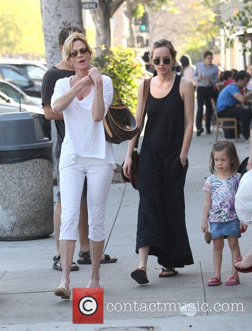 Melanie Griffth takes her daughter Dakota Johnson to...