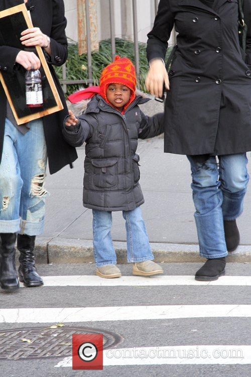 Madonna's adopted daughter Mercy James braves the cold...