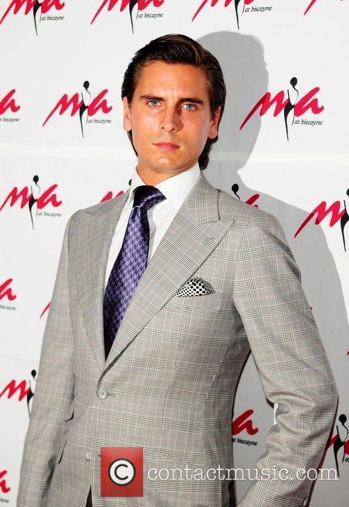Scott Disick arrives at the grand re-opening of...