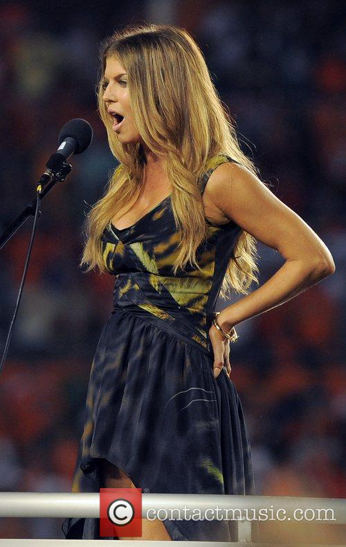 Fergie performs the national anthem at the Sun...