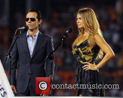 Marc Anthony and Fergie perform the national anthem...