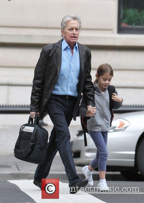 Michael Douglas walking his daughter Carys to school....