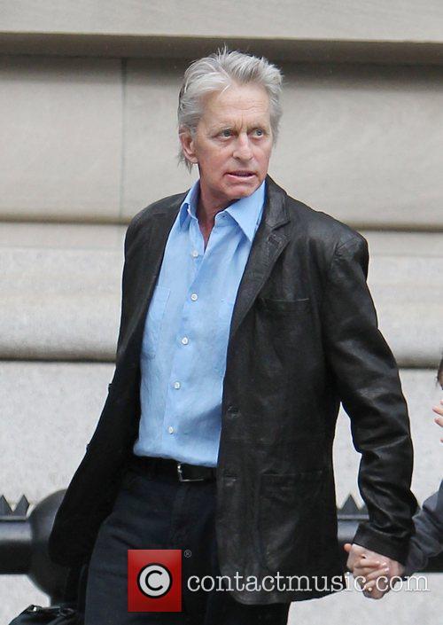 Michael Douglas walking his daughter to school. The...