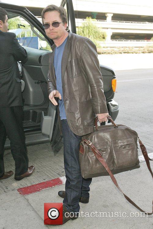 Michael J Fox arrives at LAX airport with...