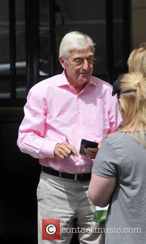 Michael Parkinson outside the Dorchester Hotel in London....