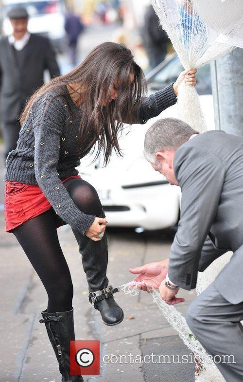 Michelle Keegan's boot buckle gets caught on the...