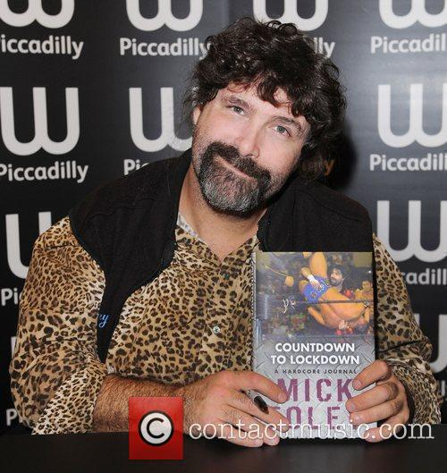 Mick Foley at a book signing of 'Countdown...