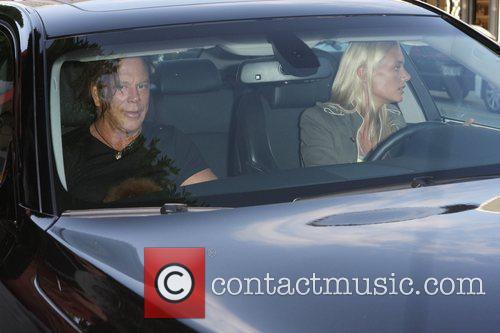 Mickey Rourke, his dog and Anastassija Makarenko drive...
