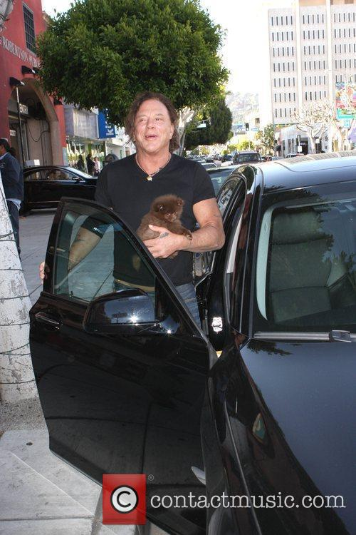 Mickey Rourke and his dog gets into his...