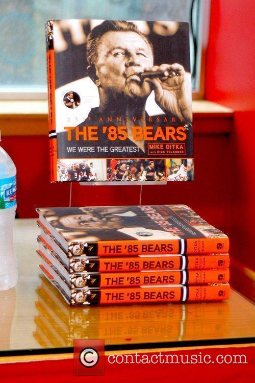 Mike Ditka signs copies of his new book...