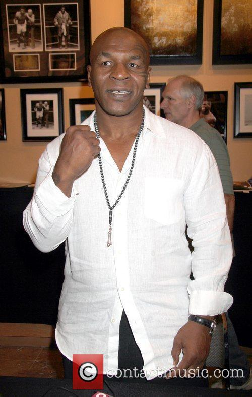 Mike Tyson aka Iron Mike signs autographs at...