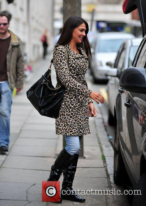 In central Liverpool with her footballer husband