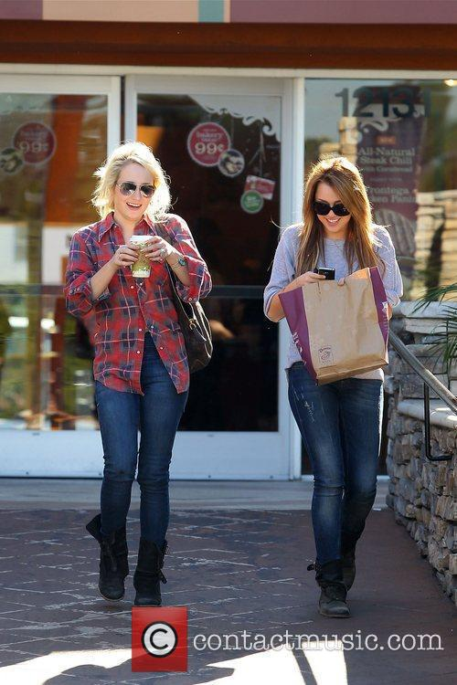 Miley Cyrus has lunch with a friend at...