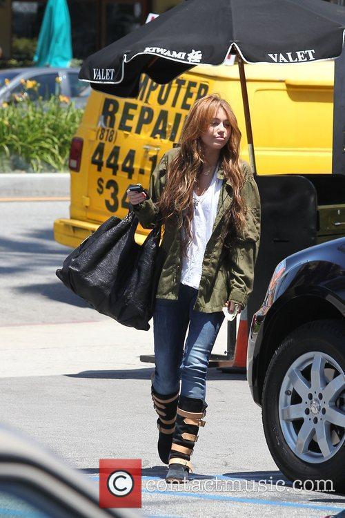 Miley Cyrus leaves Katsuya restaurant in Studio City...